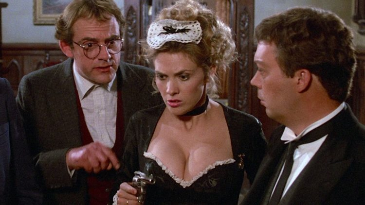 "Collen Camp wearing a French Maid outfit in the movie ""Clue"" with Tim Curry and Christopher Lloyd"